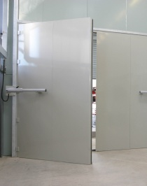 Powered acoustic doorset, 4.2m wide x 3.5m high, for vehicle testing station