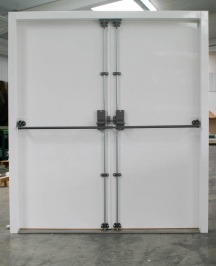 BR20 double doorset fitted with heavy duty shoot bolt to fixed leaf and heavy duty panic bar with three locking points.